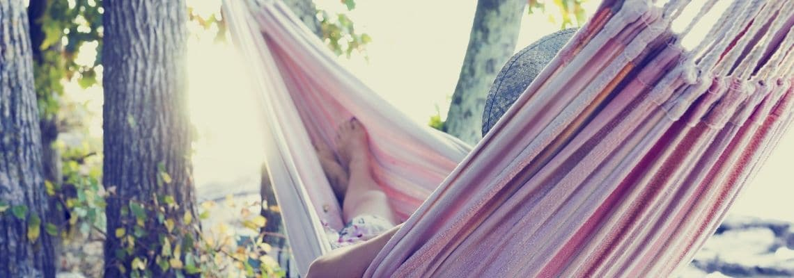 Girl Hanging in a hammock living a simple life